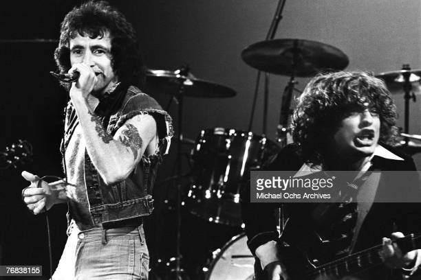 Singer Bon Scott who died in early 1980 belts out a number while guitarist Angus Young provides fiery support circa 1977 in Hollywood California