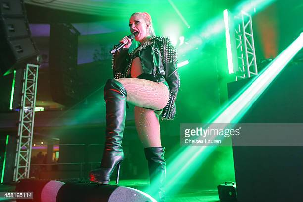 Singer Bonnie McKee performs with DJ Steve Aoki at 971 AMP Radio's Halloween Masquerade at Hollywood Palladium on October 30 2014 in Hollywood...
