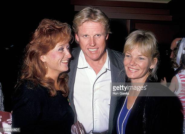 Singer Bonnie Raitt actor Gary Busey and wife Judy attend the Dancers Century City Premiere on October 7 1987 at AMC Century 14 Theatres in Century...