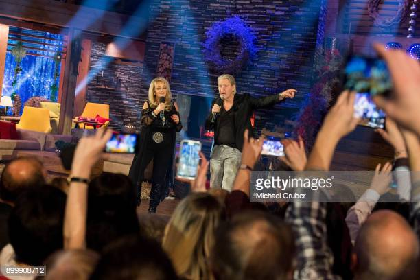 Singer Bonnie Tyler and Singer Johnny Logan performs together during the New Year's Eve tv show hosted by Joerg Pilawa on December 30, 2017 in Graz,...
