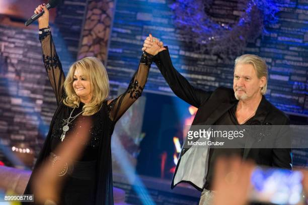 Singer Bonnie Tyler and Singer Johnny Logan performs together during the New Year's Eve tv show hosted by Joerg Pilawa on December 30 2017 in Graz...