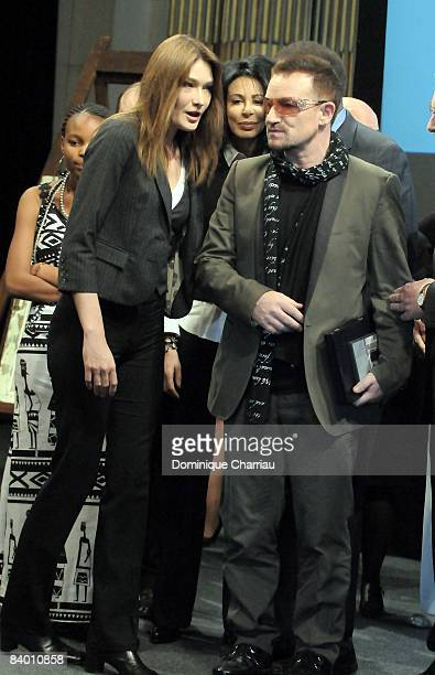 Singer Bono and Carla BruniSarkozy attend the 9th Nobel Peace Prize World Summit at the Hotel de Ville on December 12 2008 in Paris France