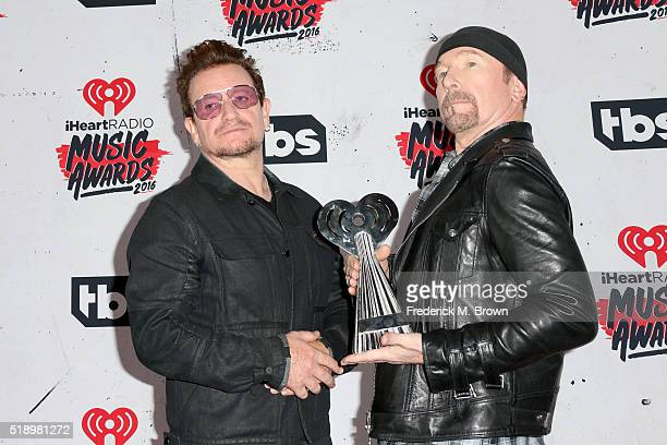 Singer Bono and musician The Edge of U2 winners of the Innovator Award pose in the press room during the iHeartRadio Music Awards at The Forum on...