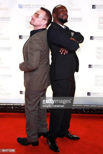 U2 singer Bono and musician Wyclef Jean attend the RFK Center Ripple of Hope Awards dinner at Pier Sixty at Chelsea Piers on November 18 2009 in New...