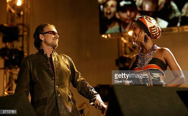Singer Bono and singer Beyonce Knowles perform at the '46664 Give One Minute of Your Life to AIDS' concert at Greenpoint Stadium on November 29 2003...