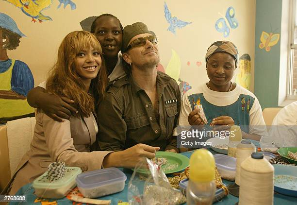 Singer Bono and singer Beyonce Knowles visit the Baphumelele orphanage for children with AIDS whose parents have died of AIDS prior to the 46664 Give...