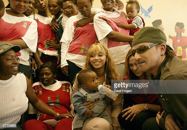 Singer Bono and singer Beyonce Knowles visit the Baphumelele orphanage for children with AIDS whose parents have died of AIDS prior to the '46664...