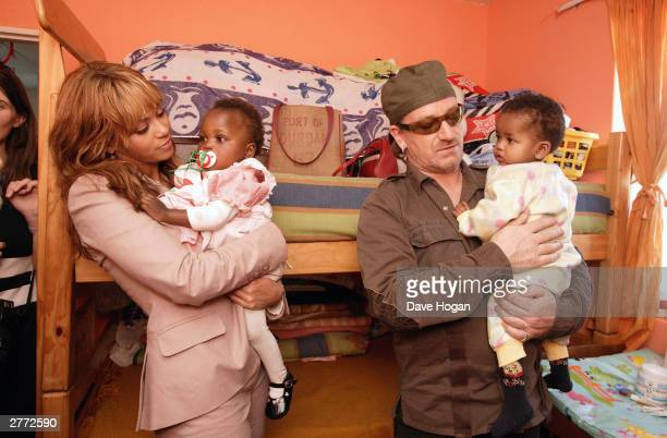 """Singer Bono and singer Beyonce Knowles visit the Baphumelele orphanage for children with AIDS whose parents have died of AIDS prior to the """"46664..."""
