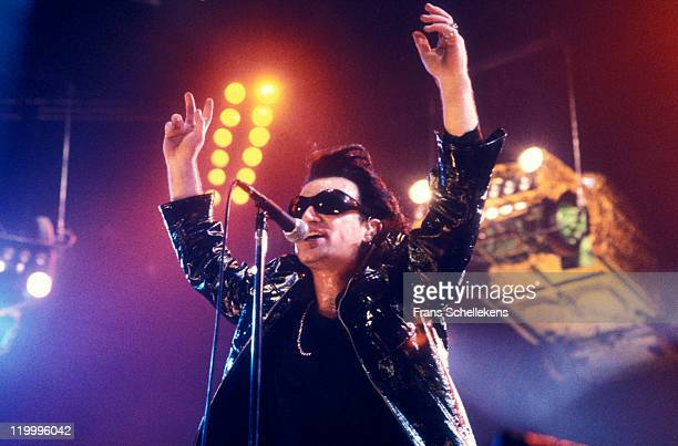 singer Bono from Irish band U2 performs live on stage at Ahoy in Rotterdam Netherlands on 15th June 1992 on the European leg of the Zoo TV tour