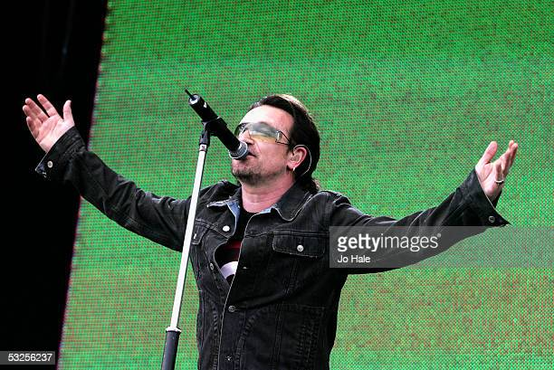 Singer Bono from the band U2 performs on stage at 'Live 8 London' in Hyde Park on July 2 2005 in London England The free concert is one of ten...
