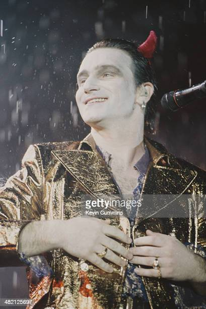 Singer Bono in his stage persona of Mr MacPhisto during a concert by Irish rock group U2 on their 'Zoo TV' tour USA 1992