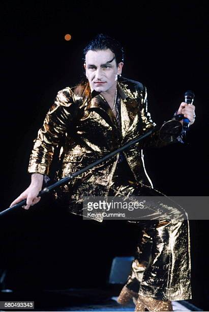 Singer Bono, in his stage persona of Mr. MacPhisto, during a concert by Irish rock group U2 on their 'Zoo TV' tour, 1992.