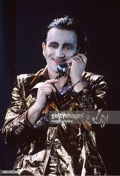 Singer Bono in his stage persona of Mr MacPhisto during a concert by Irish rock group U2 on their 'Zoo TV' tour 1992