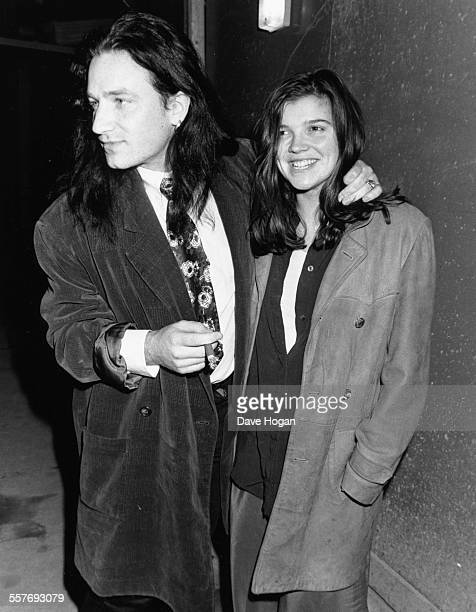Singer Bono of the band 'U2' and his wife Ali Hewson outside Langan's restaurant in London February 1989
