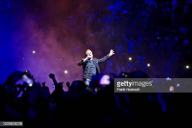 Singer Bono of the Irish band U2 performs live on stage during a concert at the MercedesBenz Arena on August 31 2017 in Berlin Germany