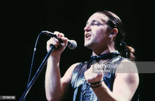 Singer Bono of the rock group U2 performs songs from 'The Joshua Tree' album during a 1987 Inglewood California concert at the Forum