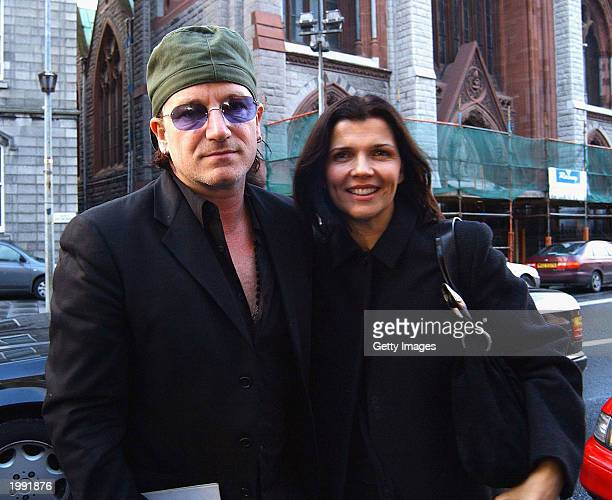 Singer Bono of U2 and wife Ali Hewson attend a Neil Young concert in Vicar Street May 8 2003 in Dublin Ireland
