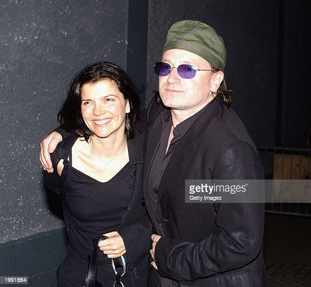 Singer Bono of U2 and wife Ali Hewson attend a Neil Young concert in Vicar Street May 8, 2003 in Dublin, Ireland.