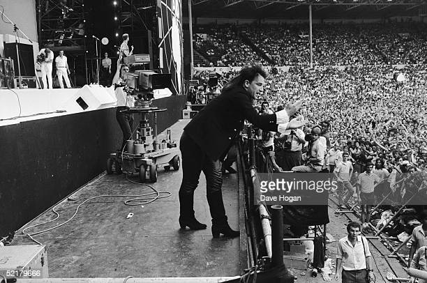 U2 singer Bono performing at the Live Aid event in front of a large crowd at Wembley 13th July 1985