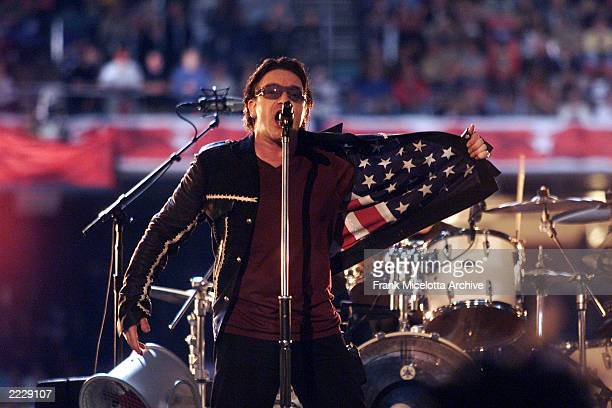 Singer Bono performing on the Super Bowl XXXVI - Halftime Show at the Louisiana Superdome in New Orleans, LA., 2/3/02. Photo by Frank Micelotta/Getty...