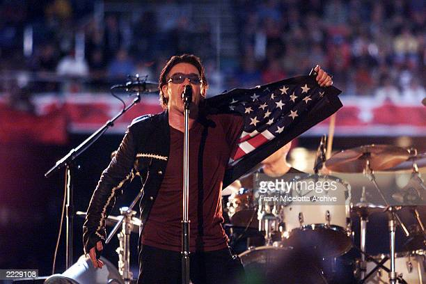 U2 singer Bono performing on the Super Bowl XXXVI Halftime Show at the Louisiana Superdome in New Orleans LA 2/3/02 Photo by Frank Micelotta/Getty...