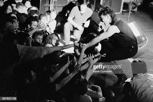 Singer Bono performing with Irish rock group U2 at Leeds University 18th March 1983