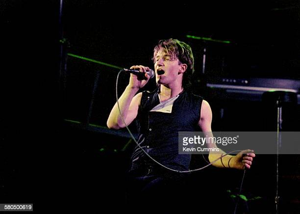 Singer Bono performing with Irish rock group U2 at the Manchester Apollo December 1982