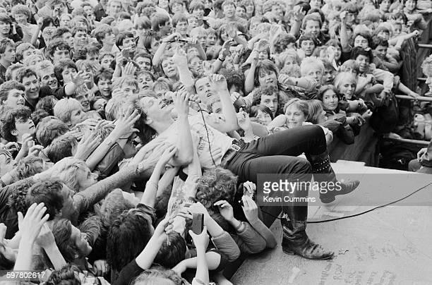 Singer Bono performing with Irish rock group U2 Gateshead July 1982