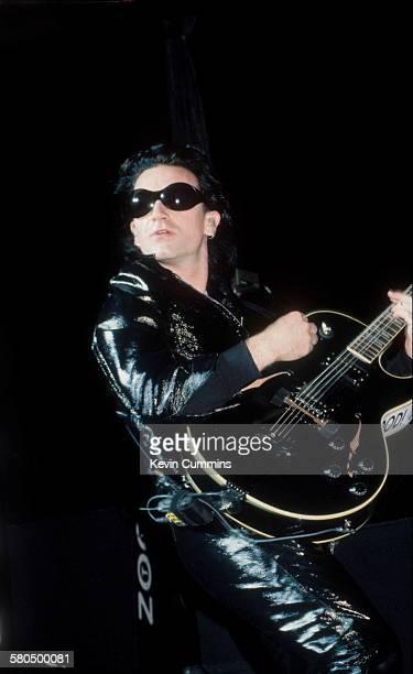 Singer Bono performing with Irish rock group U2 on their 'Zoo TV' tour 1992
