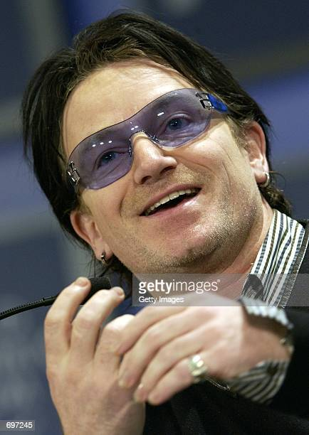 Singer Bono reacts February 2002 during a session of the 32nd Annual Meeting of the World Economic Forum at the WaldorfAstoria hotel in New York The...