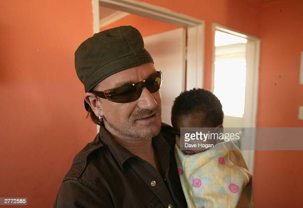 """Singer Bono visits the Baphumelele orphanage for children with AIDS whose parents have died of AIDS prior to the """"46664 Give One Minute Of Your Life..."""