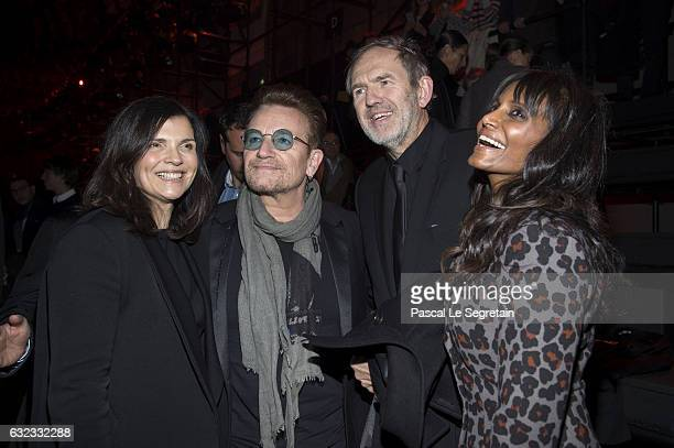Singer Bono with his wife Ali Hewson photographer Anton Corbijn and designer Nimi Ponnudurai attend the Dior Homme Menswear Fall/Winter 20172018 show...