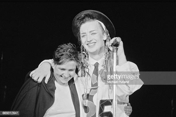 Singer Boy George of British new romantic group Culture Club on stage with backing singer Helen Terry during a performance in Washington DC August...