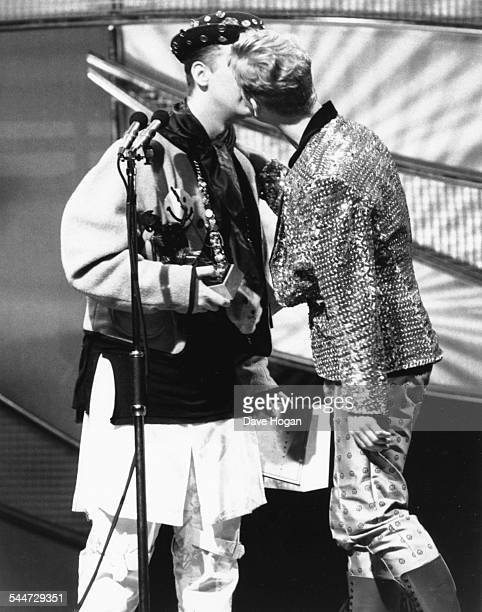 Singer Boy George of the band Culture Club kissing Andy Bell of the band 'Erasure' on stage at the Brit Awards London February 15th 1989