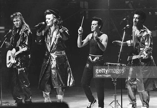 Singer Boy George with his band 'Culture Club' performing on stage circa 1988