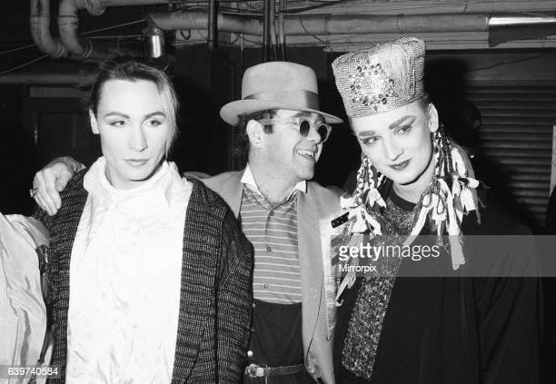 Singer Boy George with with friend Marilyn and Elton John during the Culture Club concert at Wembley 22nd December 1984