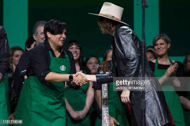 Singer Brandi Carlile shakes hands with Starbucks employees at the Annual Meeting of Shareholders in Seattle Washington on March 20 2019
