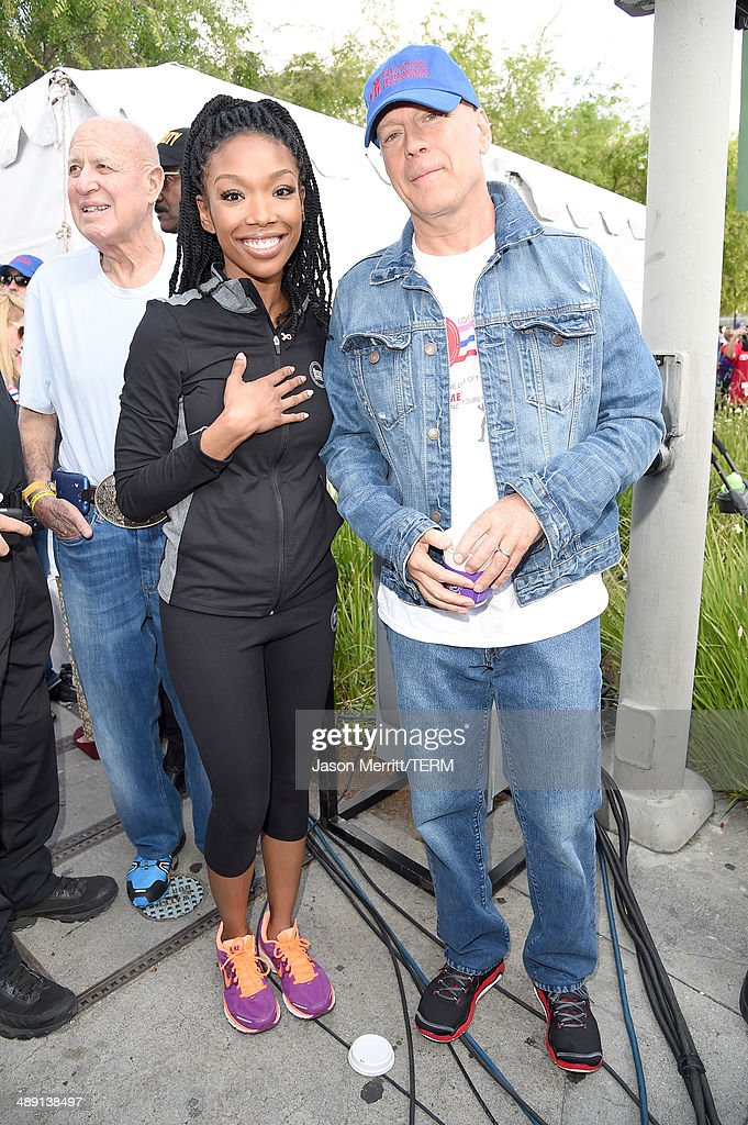 Singer Brandy and actor Bruce Willis (R) attend the 21st Annual EIF Revlon Run Walk For Women on May 10, 2014 in Los Angeles, California.
