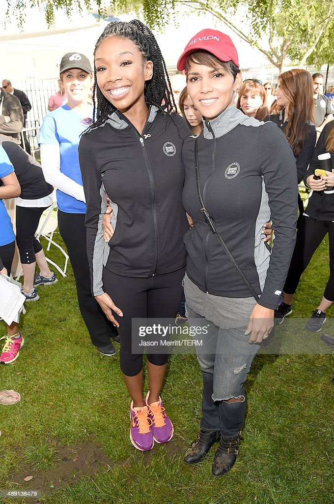 Singer Brandy and actress Halle Berry (R) attend he 21st Annual EIF Revlon Run Walk For Women on May 10, 2014 in Los Angeles, California.