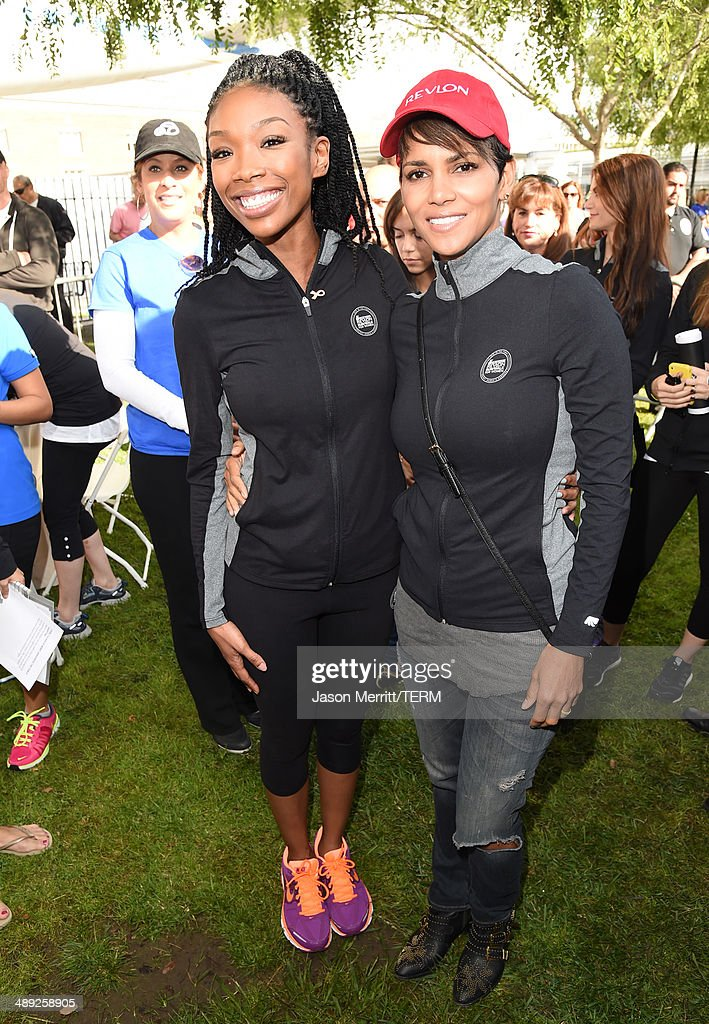 Singer Brandy (L) and actress Halle Berry attends the 21st Annual EIF Revlon Run Walk For Women on May 10, 2014 in Los Angeles, California.