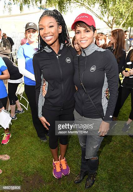 Singer Brandy and actress Halle Berry attends the 21st Annual EIF Revlon Run Walk For Women on May 10 2014 in Los Angeles California