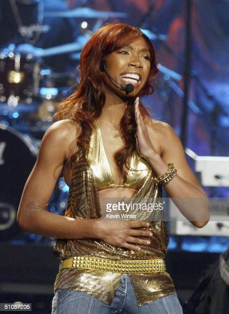 Singer Brandy performs on 'The Tonight Show with Jay Leno' at the NBC Studios on July 13 2004 in Burbank California