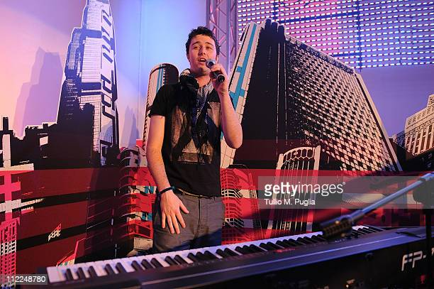 Singer Brendan Croskerry performs during Benedict Radcliffe wireframe design installation inspired by Range Rover Evoque at the Opificio 31 during...