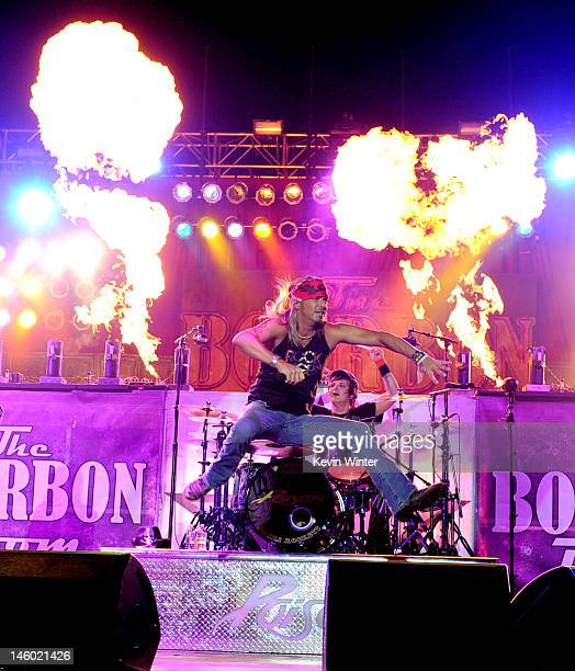 """Singer Bret Michaels and musician Rikki Rockett of Poison perform at the after party for the premiere of Warner Bros. Pictures' """"Rock Of Ages"""" at..."""