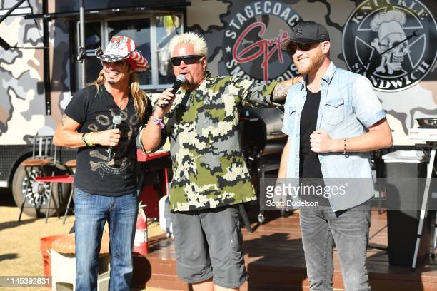 Singer Bret Michaels chef Guy Fieri and Cole Swindell attend Day 1 of the 2019 Stagecoach Country Music Festival on April 26 2019 in Indio California