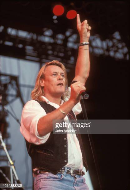 Singer Brian Howe is shown performing on stage during a live concert appearance with Bad Company on July 26 1990