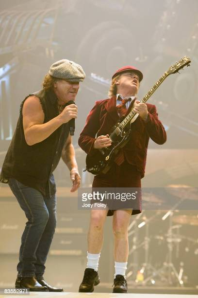 Singer Brian Johnson and guitarist Angus Young of AC/DC perform in concert during their 'Black Ice World Tour' at the Conseco Fieldhouse on November...