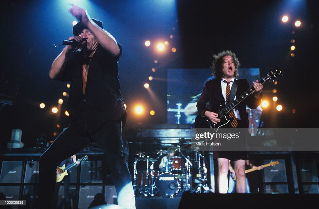 Singer Brian Johnson and guitarist Angus Young of AC/DC perform on stage at Wembley Arena in London, England in June 1996.