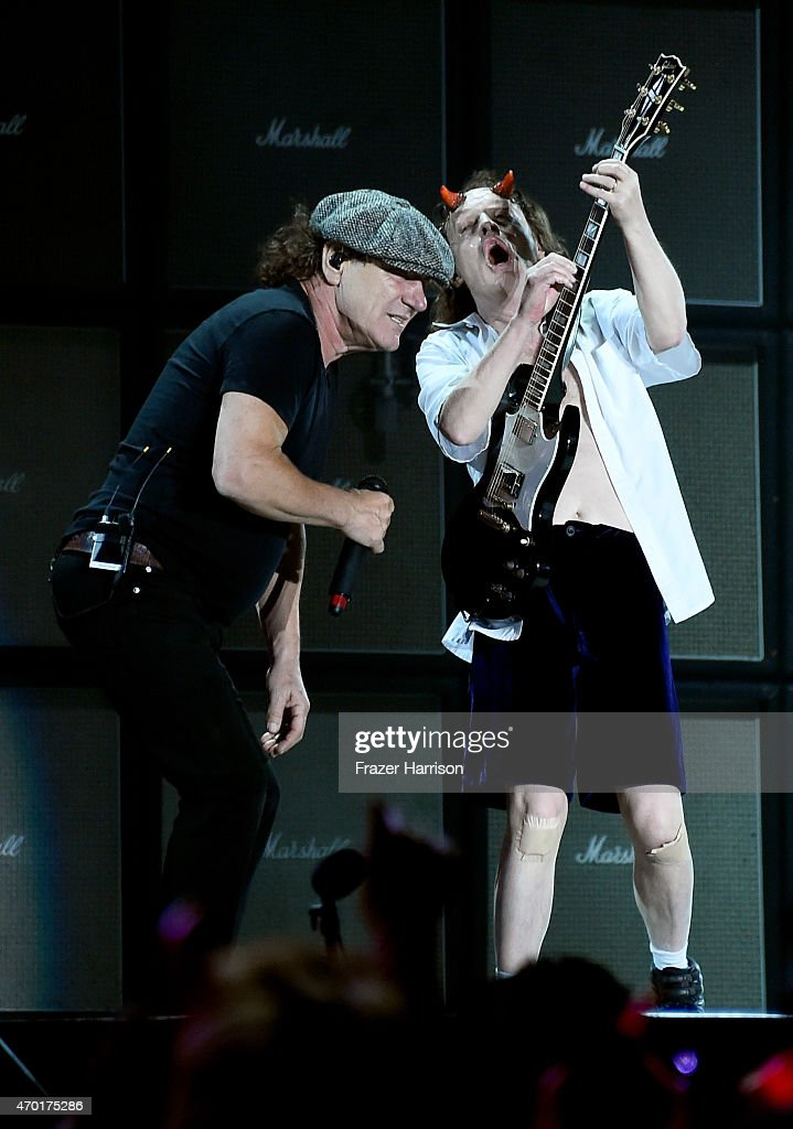 Singer Brian Johnson (L) and musician Angus Young of AC/DC perform onstage during day 1 of the 2015 Coachella Valley Music And Arts Festival (Weekend 2) at The Empire Polo Club on April 17, 2015 in Indio, California.