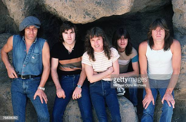 Singer Brian Johnson drummer Simon Wright lead guitarist Angus Young rhythm guitarist Malcolm Young and bassist Cliff Williams of AC/DC pose for a...